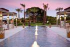 View of the swimming pool at Epic Sana at sunset
