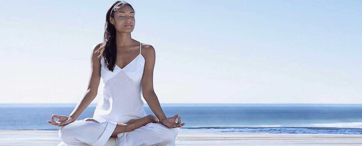 Women practising Mindfulness yoga